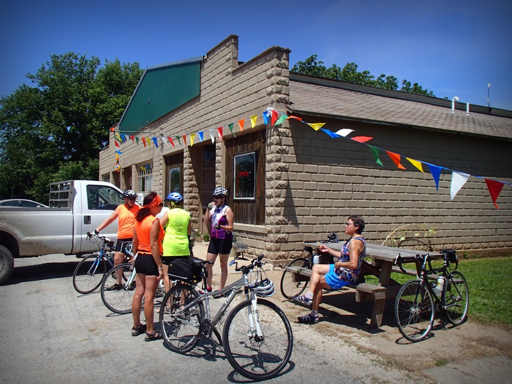 Bicyclists take a break at the Mildred Store in Mildred, Kansas.